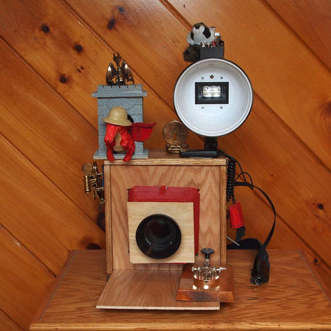 Front view of disguised camera with dragons